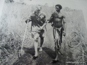 One of the most touching images from the war - injured in the fighting, Private George C. 'Dick' Whittington is guided towards a field hospital by Raphael Oembari