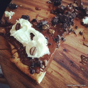 Dark chocolate, chocolate crumble, coffee beans and cream - on a pizza!