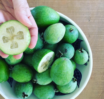 hand showing inside of a feijoa