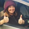 Shannon gives thumbs up at the start of her epic van trip